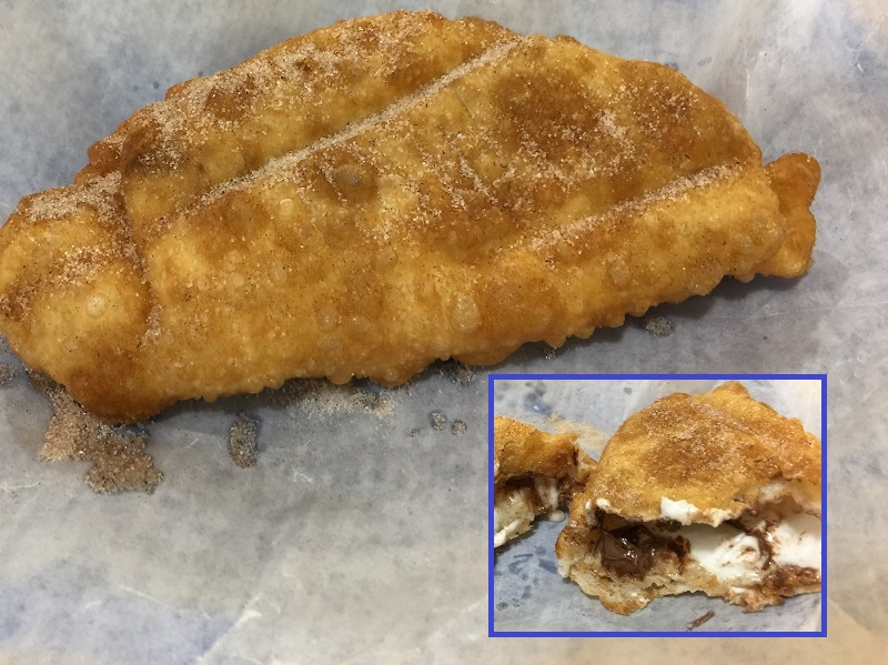 Sopapilla with chocolate and melted marshmallow paste inside