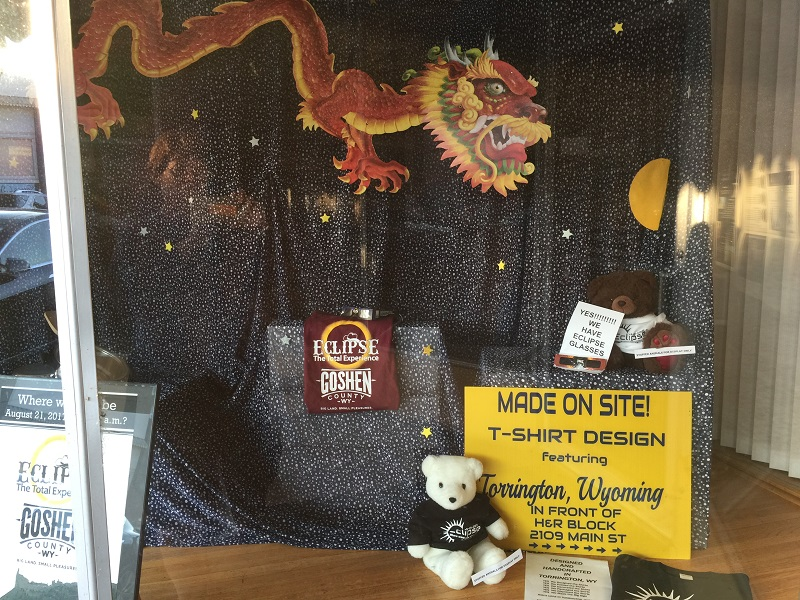 Business window in Torrington celebrating eclipse